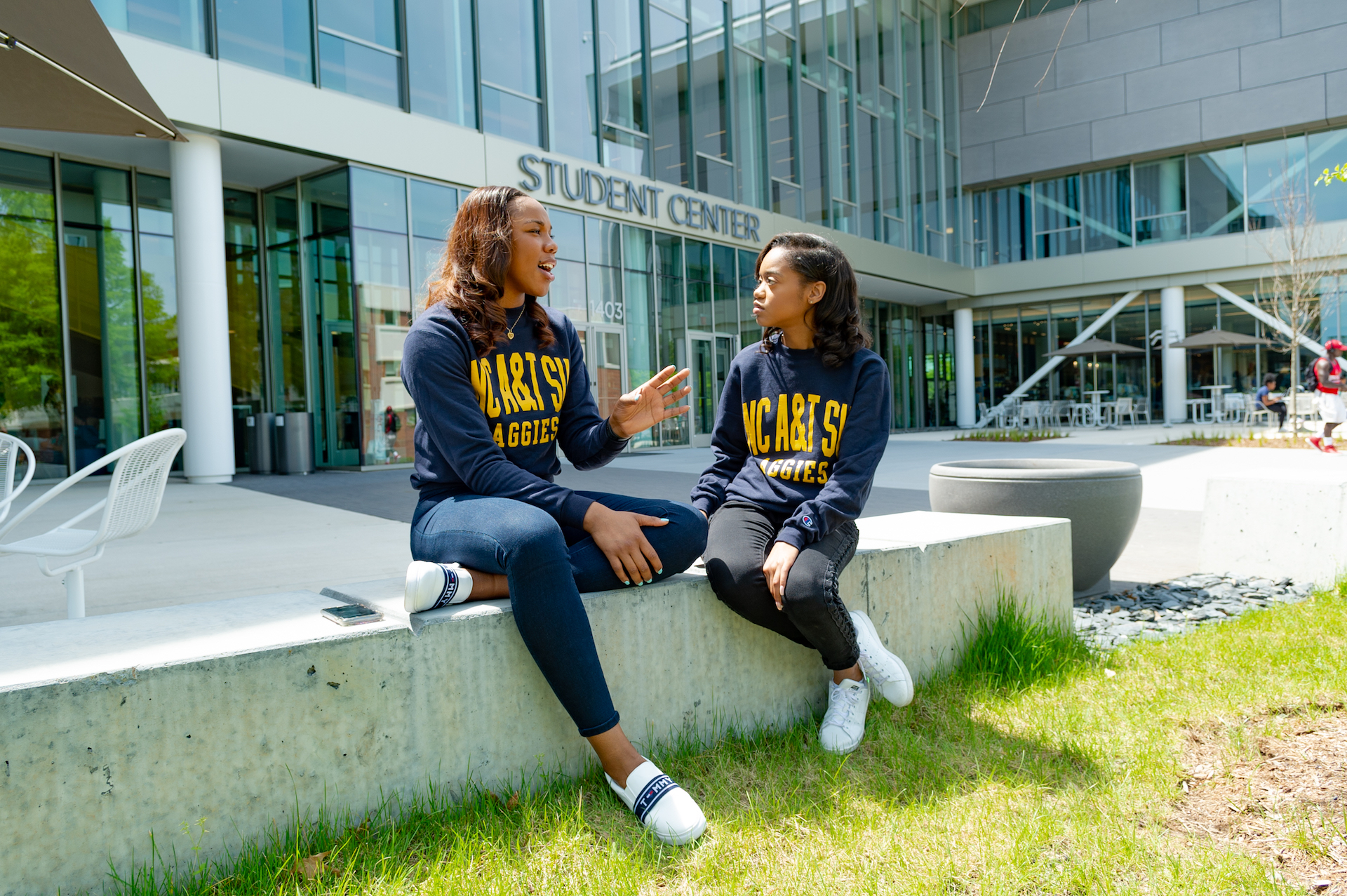 2 female students  outside of the student center